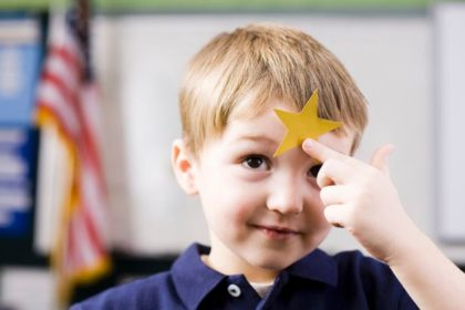 Child with gold star on head
